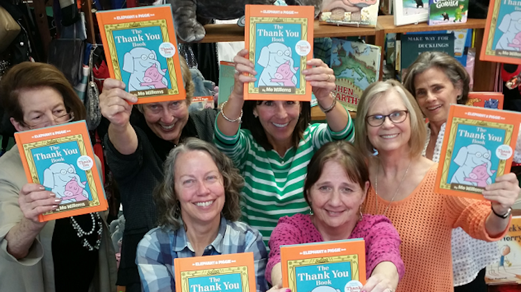 The Bookies staff with The Thank You Book by Mo Willems