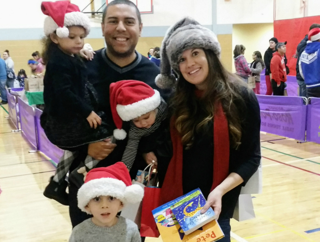 The Bookies Bookstore gave out books at the Glendale YMCA Christmas party